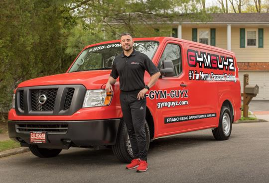 GYMGUYZ Van in front of client's house